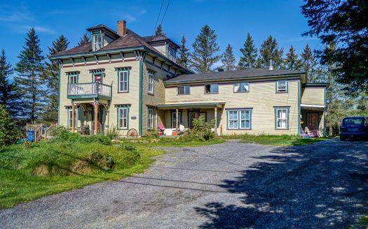 Bigénération ancestral à vendre rue Bellevue Mansonville Potton Flex Immobilier Élévation latérale