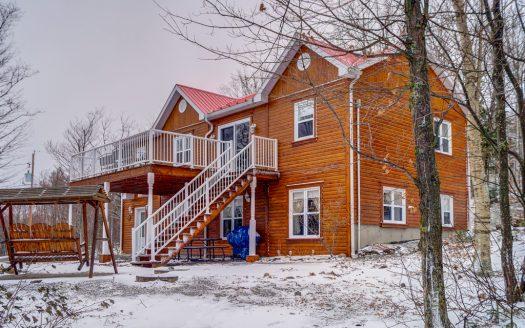 Chalet avec vue à vendre à louer Domaine des Montagnais Val-Racine Flex Immobilier Élévation avant