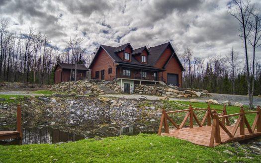 Maison avec garage à vendre chemin Rhéaume Sherbrooke St-Élie-d'Orford Flex Immobilier Lac artificiel et élévation avant
