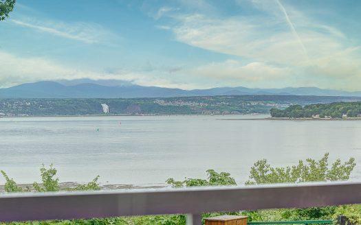 Condo au bord du fleuve à vendre Lévis Québec Flex Immobilier Vue sur le fleuve St-Laurent à partir du balcon (rez-de-chaussée)